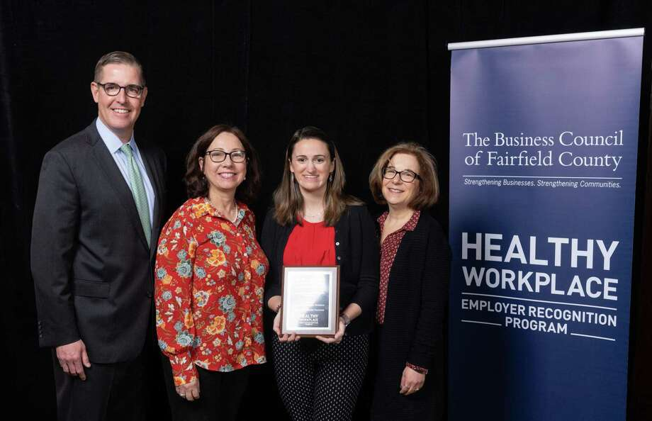 Accepting a Healthy Workplace award from the Fairfield County Business Council, from left, Matthew Fair, vice president, USI Insurance Services and co-chair of the Healthy, Wellbeing and Safety Roundtable, Sharyn Cannon, Tauck chief culture officer, Hailey Sauerhoff, Tauck benefits/wellness coordinator, and Liz Malett, Tauck senior manager, Human Resources. Photo: Contributed Photo / HAPPYHAHA.COM