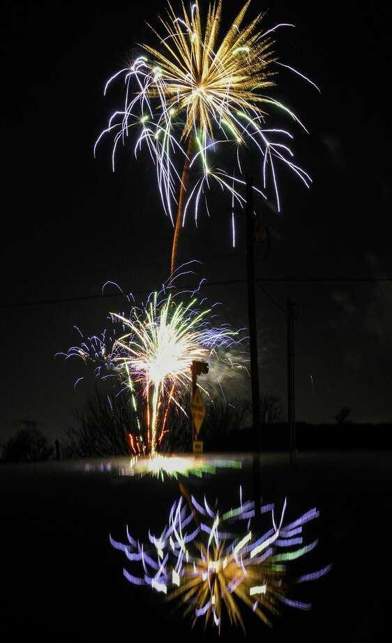 Fireworks are reflected of the roof of a car on Highway 59, Sunday, Feb. 23, 2020, during the H-E-B Fireworks Extravaganza show. The event marks the end of this year's WBCA festivities. Photo: Danny Zaragoza/Laredo Morning Times