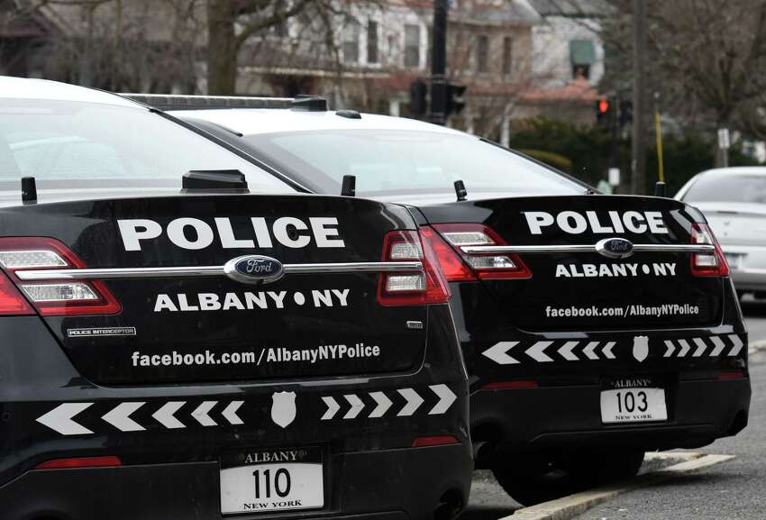 Albany Police Department cars are parked outside the Sixth Precinct station on Tuesday, Feb. 25, 2020, in Albany, N.Y. (Will Waldron/Times Union)