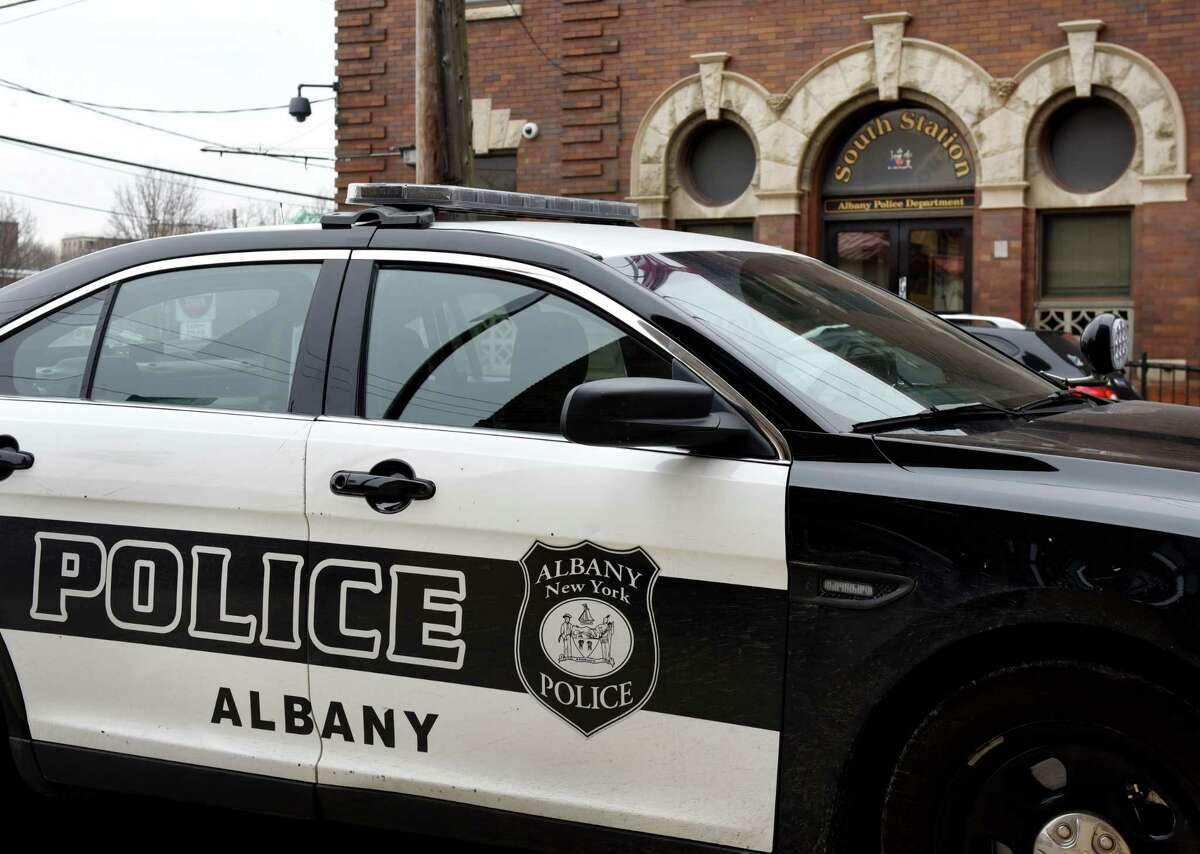 An Albany police car is parked outside the Albany Police Department South Station on Tuesday, Feb. 25, 2020, in Albany, N.Y. (Will Waldron/Times Union)
