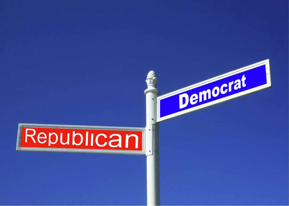 Street sign against a clear blue sky depicting Republican vs Democrat Party. Photo: Dreamstime