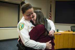City of Midland Police Chief Nicole Ford hugs her daughter, Mackenzie Ford, 19, after a swearing-in ceremony for Ford Monday, Feb. 24, 2020 at City Hall. Ford is the first woman to serve as Police Chief in Midland. (Katy Kildee/kkildee@mdn.net)