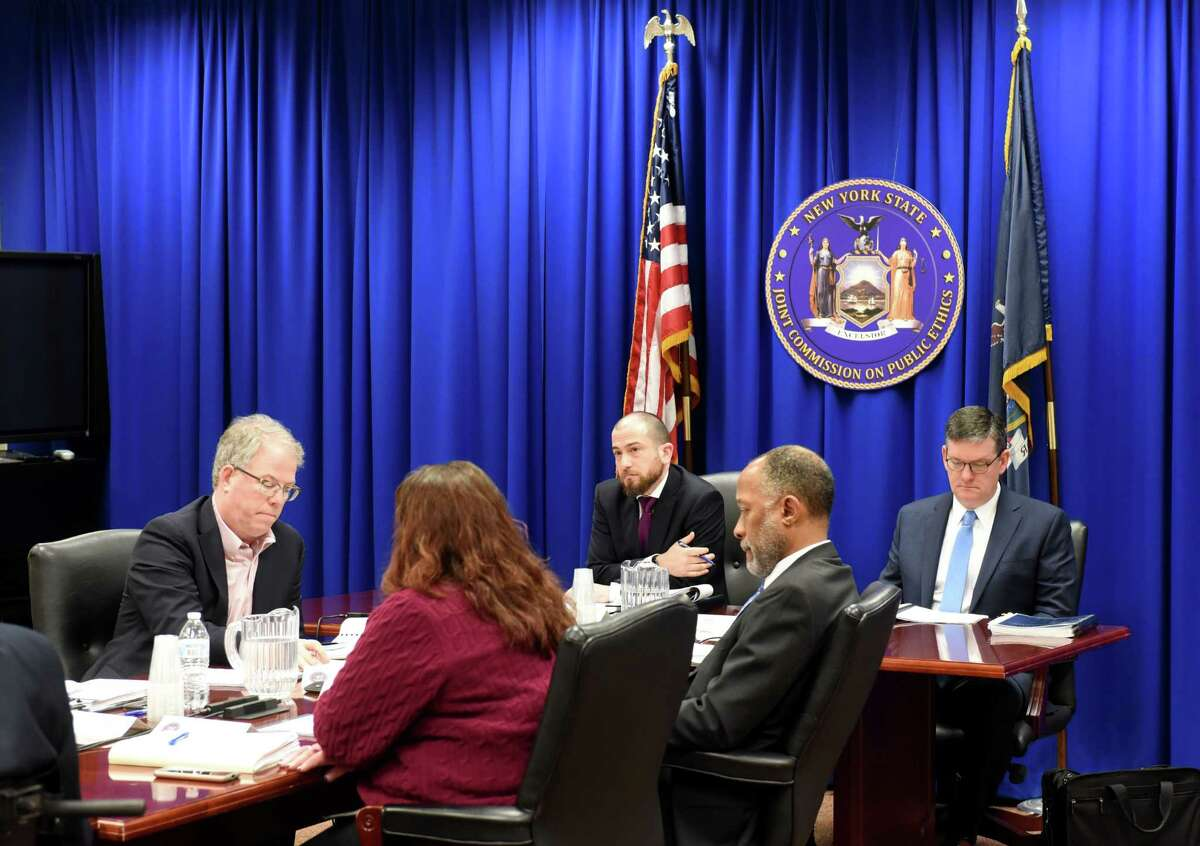 Members of the New York State Joint Commission on Public Ethics gather at the JCOPE Broadway office for a meeting on Tuesday, Feb. 25, 2020, in Albany, N.Y. (Will Waldron/Times Union)