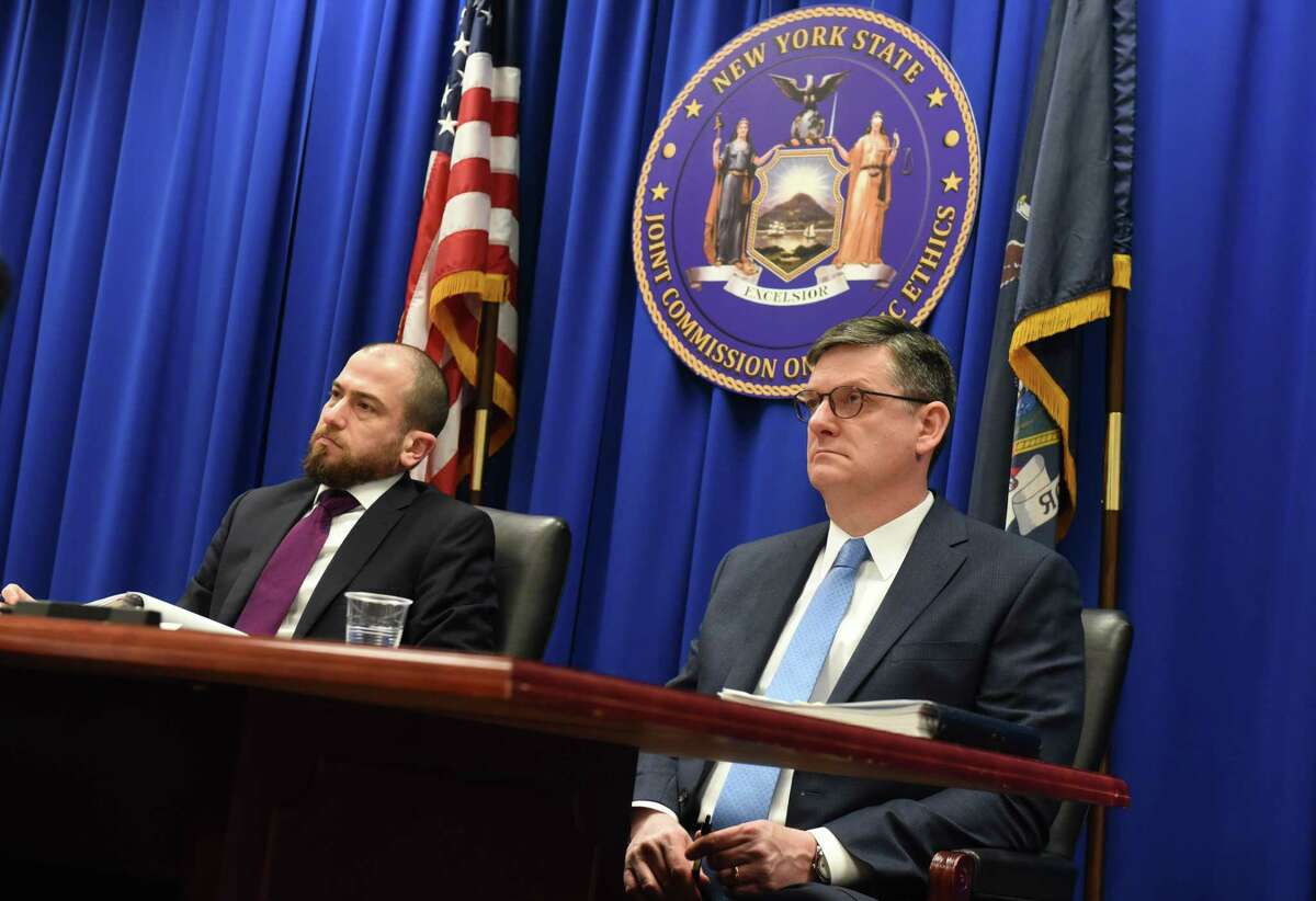 Martin Levine, deputy general counsel to the New York State Joint Commission on Public Ethics, left, and JCOPE Commissioners James Derring, right, listen to Commissioner Gary Lavine during a commission meeting on Tuesday, Feb. 25, 2020, in Albany, N.Y. (Will Waldron/Times Union)