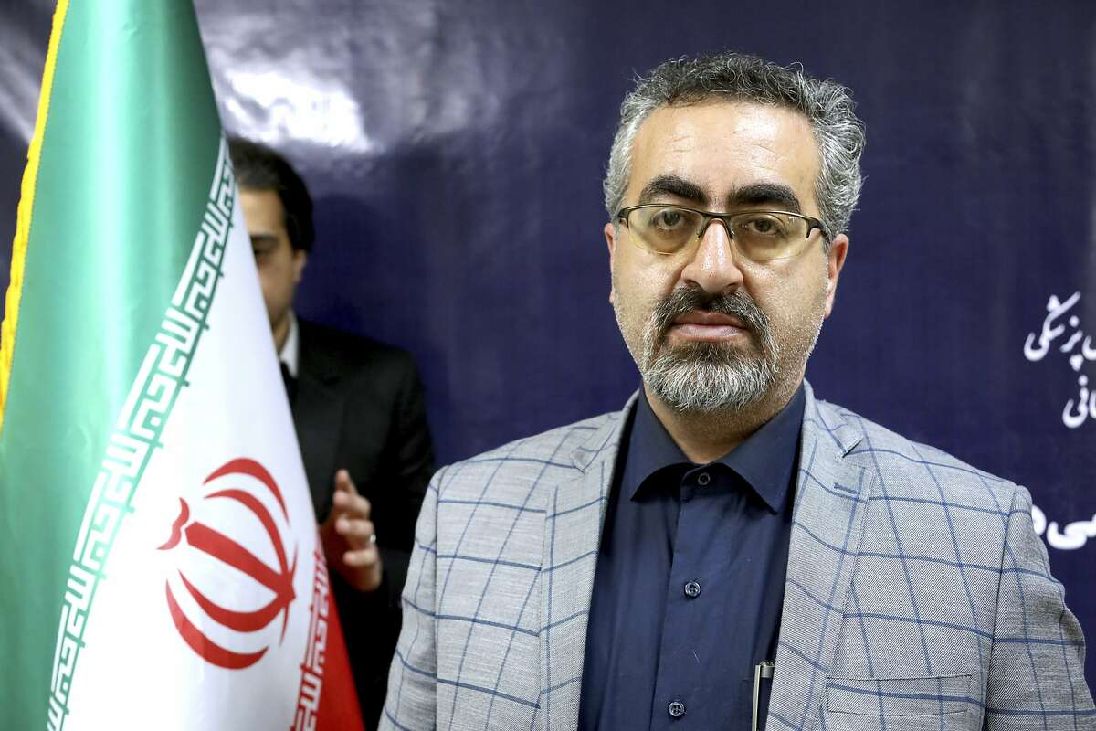 Spokesman for Iran's Health Ministry Kianoush Jahanpour poses for a photo before an interview in Tehran, Iran, Tuesday, Feb. 25, 2020. The head of Iran's counter-coronavirus task force has tested positive for the virus himself, authorities announced Tuesday, showing the challenges facing the Islamic Republic amid concerns the outbreak may be far wider than officially acknowledged. The announcement comes as countries across the Mideast say they've had confirmed cases of the virus that link back to Iran, which for days denied having the virus. (AP Photo/Ebrahim Noroozi)