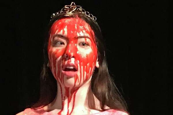 """The North East School of the Arts staging of """"Carrie the Musical"""" stars Claire McGinlay in the title role. The show will include video shot by the school's cinema department, including images of Carrie after a bucket of blood is dumped on her at the prom."""
