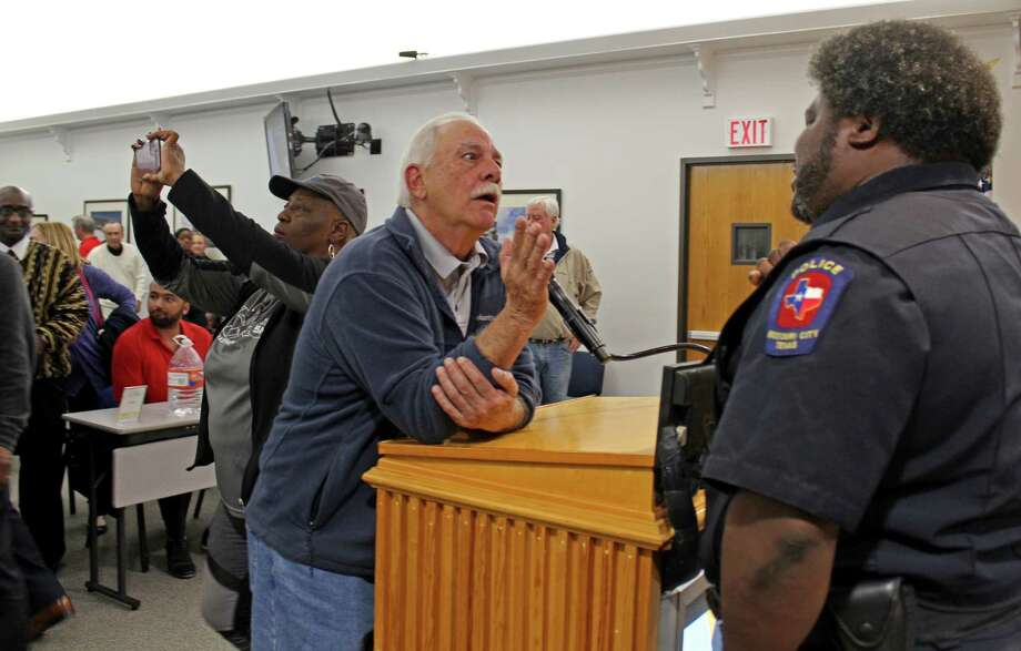 An upset resident talks with a Missouri City Police officer after a special meeting held Tuesday, Feb. 24, when Mayor Yolanda Ford and the City Council voted 4-to-3 to terminate the contract of City Manager Anthony Snipes residents. Photo: Kristi Nix, Staff Photo
