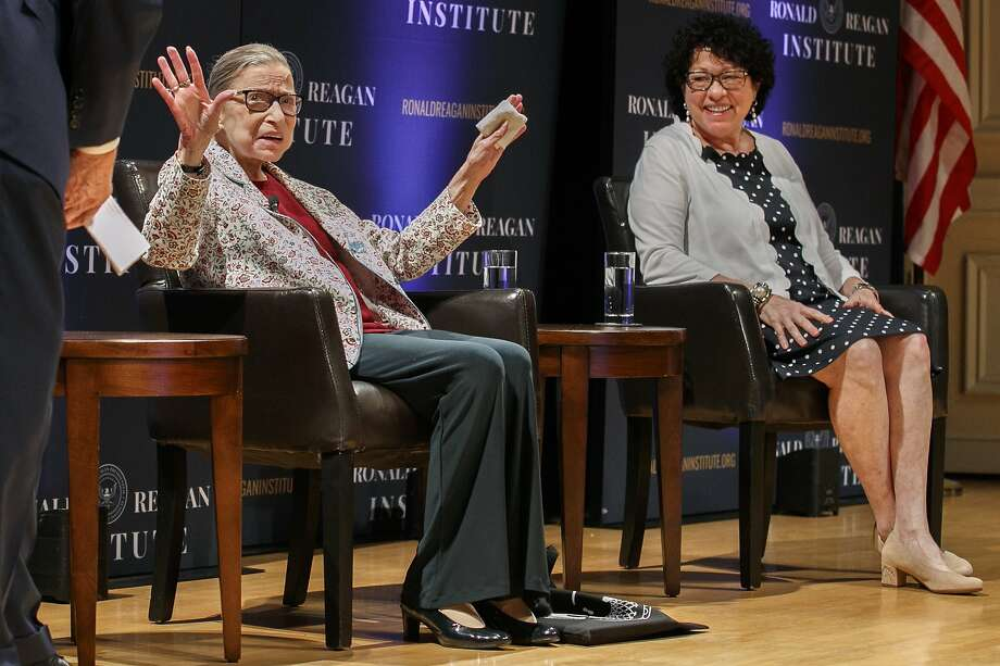 FILE - In this Sept. 25, 2019 file photo, Supreme Court Justice Ruth Bader Ginsburg, left, holds up her hands as she and Supreme Court Justice Sonia Sotomayor arrive to applause for a panel discussion celebrating Sandra Day O'Connor, the first woman to be a Supreme Court Justice, at the Library of Congress in Washington. A month before the Supreme Court takes up cases over his tax returns and financial records, President Donald Trump on Tuesday made the unusual suggestion that two liberal justices should not take part in those or any other cases involving him or his administration. The remarks critical of Justices Ruth Bader Ginsburg and Sonia Sotomayor came during a news conference in India, where Trump was wrapping up a 36-hour visit.   (AP Photo/Jacquelyn Martin) Photo: Jacquelyn Martin, Associated Press