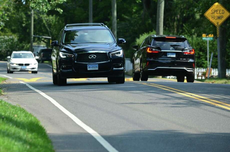 Traffic along Old Hill Road Wednesday, September 4, 2019, in Westport, Conn. Westport has some of the areas with the longest-lived people. The Westport neighborhood the highest life expectancy, often reffered to as the Old Hill section, borders Norwalk and Wilton to the west, Route 1 to the south, Wilton and Weston to the north, and the Saugatuck River to the east. Photo: Erik Trautmann / Hearst Connecticut Media / Norwalk Hour