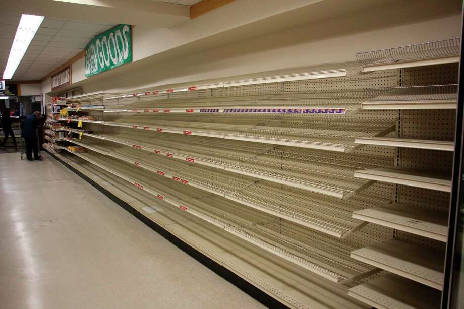 The shelves of McDonald's Food and Family clear out, indicating its final days. (Sara Eisinger/Huron Daily Tribune)