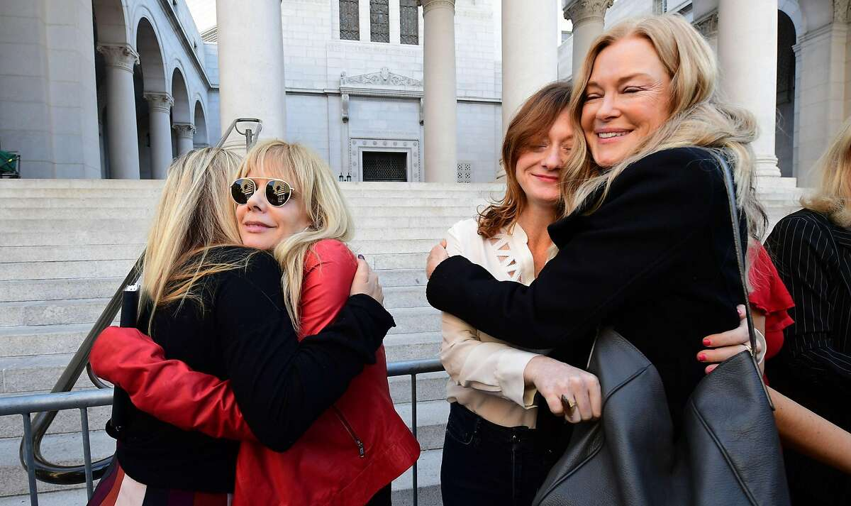 Actress Rosanna Arquette (2ndL) embraces Jessica Barth as a group of Hollywood actresses and others part of a group of Silence Breakers who have fought for justice by speaking out about Harvey Weinsteins sexual misconduct, gather during a press conference following Harvey Weinsteins guilty verdict on February 25, 2020 in Los Angeles,California. - Harvey Weinstein was convicted February 24, 2020 of rape and sexual assault but acquitted of the most serious predatory charges, a verdict hailed as a historic victory by the #MeToo movement against sexual misconduct. (Photo by Frederic J. BROWN / AFP) (Photo by FREDERIC J. BROWN/AFP via Getty Images)