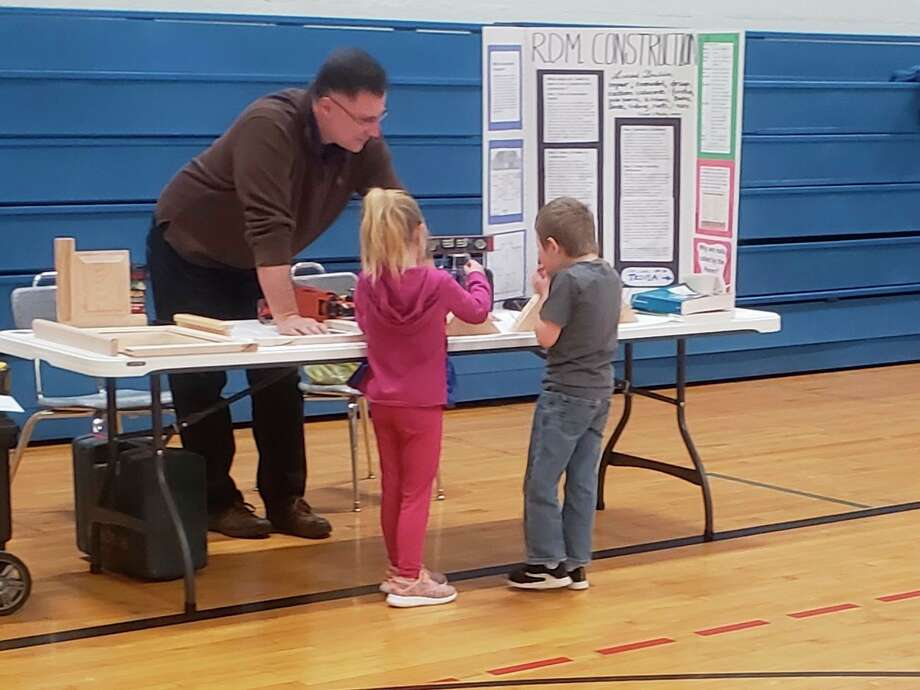 The R.D.M Construction booth was one of the many popular stops for students taking part in the Brethren Schools Trade Fair. (Courtesy photo)