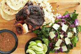 Smoked beef shin is served with house-made tortillas, borracho beans and three-kale salad at Woodshed Smokehouse, a barbecue restaurant that chef Tim Love is opening in Levy Park.