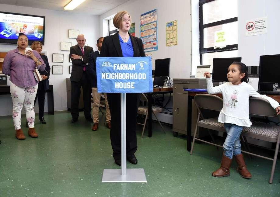 Preschooler Sophia Ortiz (right), 5, listens to Jennifer Ricker, Executive Director of Concepts for Adaptive Learning, speak at a ribbon cutting ceremony for the Curtis Hill Computer Center at the Farnam Neighborhood House in New Haven on February 25, 2020. Adults are given a computer after completing a six-week computer class at the Farnam Neighborhood House which partners with Concepts for Adaptive Learning. About 10 people per month compete the program at this location. Photo: Arnold Gold / Hearst Connecticut Media / New Haven Register