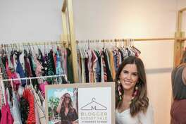 """The annual Blogger Closet Sale is scheduled from 10 a.m. until 6 p.m., Saturday, February 29, at Market Street in The Woodlands. Gently worn clothing and other items will be on sale at discounted prices from six local """"fashion influencers"""" who will be on hand. Here, one of the 'influencers,' Brittany Fullwood, shows off some of the clothes she'll have on sale."""