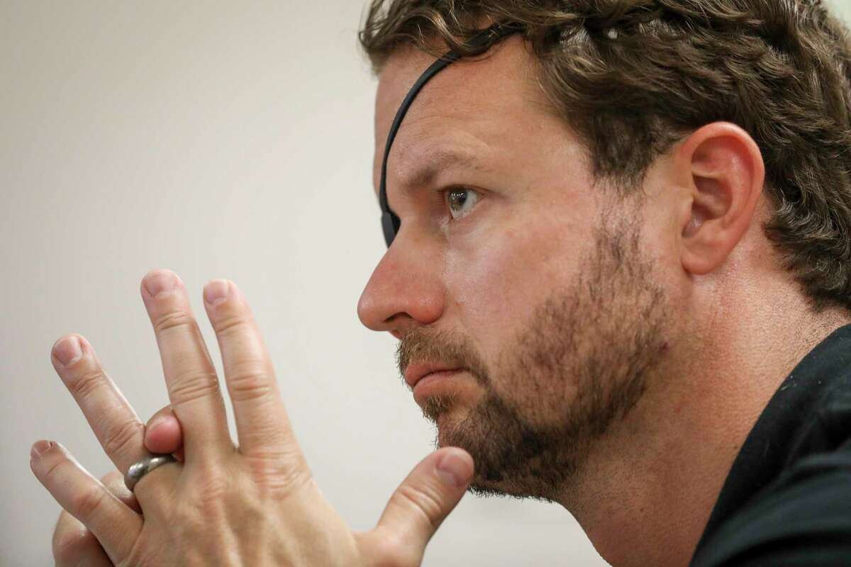 U.S. Rep. Dan Crenshaw listens to a briefing about the Addicks and Barker Reservoirs on Friday, Aug. 16, 2019, in Houston.