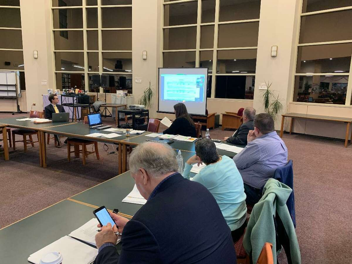Members of the Ansonia-Derby Temporary School Regionalization Study Committee confer with Simone Carpenter, of District Management Group in Boston through video conferencing. Carpenter explained the costs of upgrading, expanding and addressing code violations in the districts' schools.