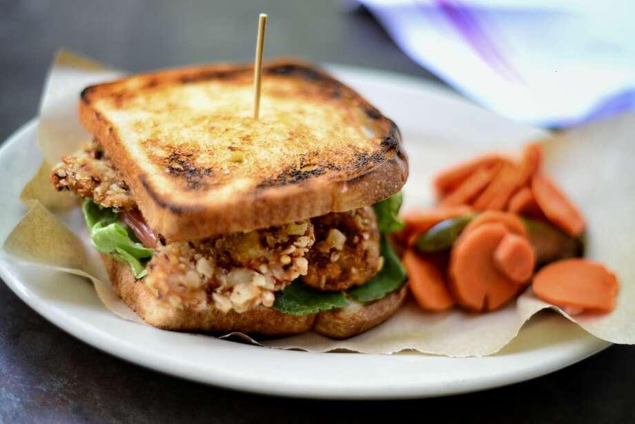 Esquire Tavern Shrimp toast $12, shrimp sandwich $16 and fish & chips $16. 155 E. Commerce St. Photo: Courtesy, Kody Melton