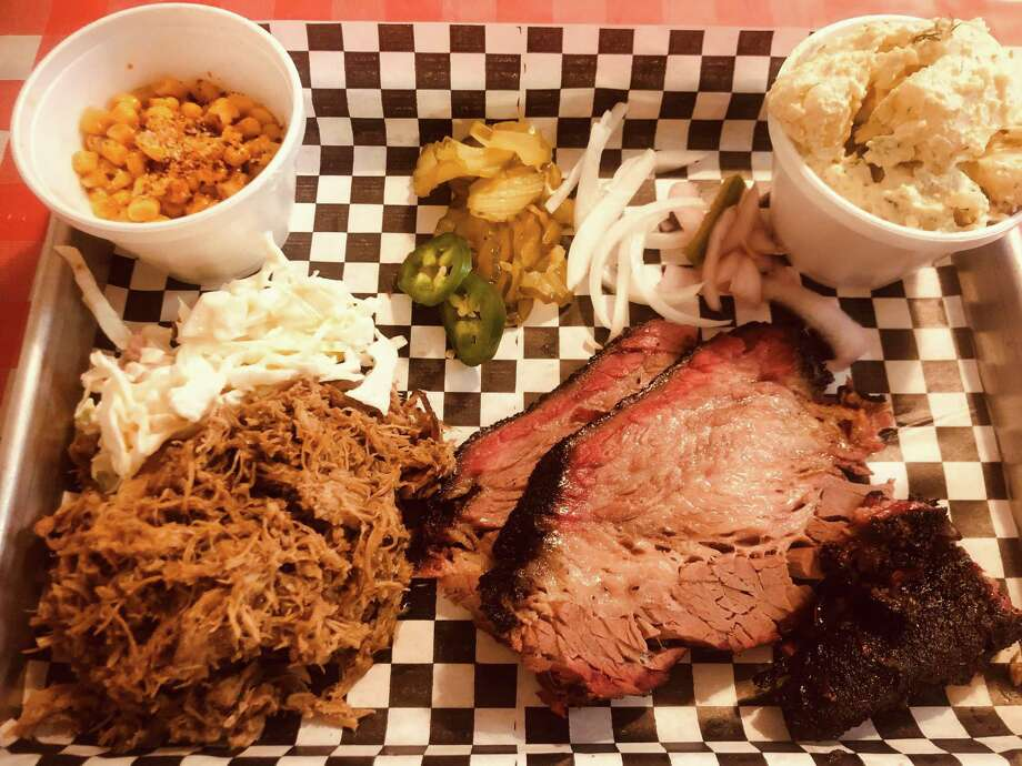 A plate of brisket and pulled pork with sides of smoked corn and potato salad at The Hot Box. Photo: Hot Box