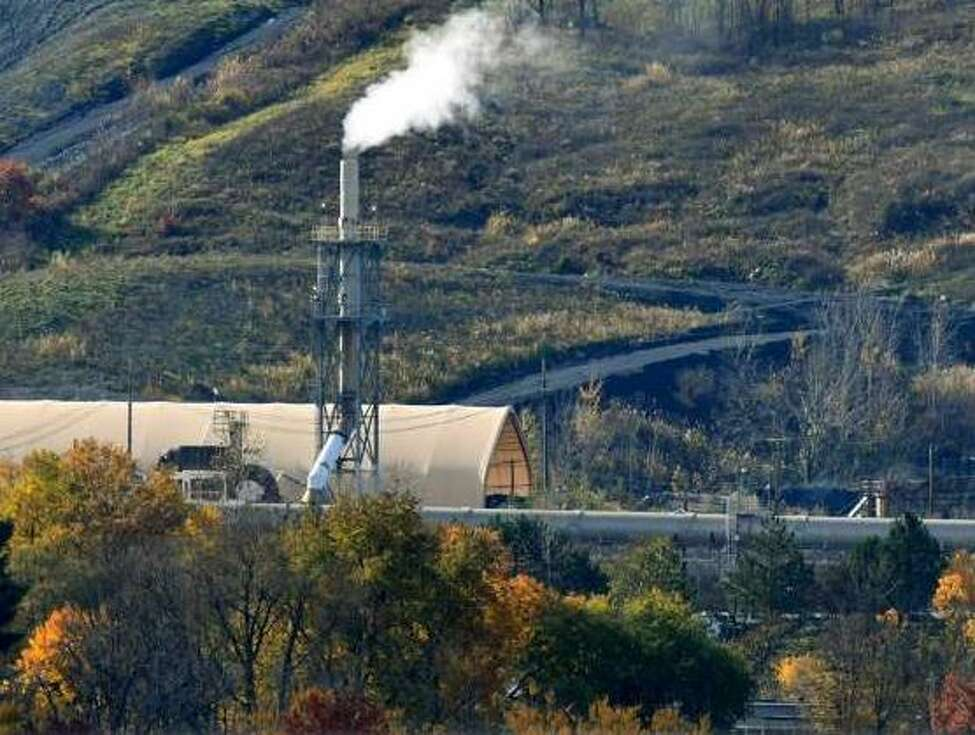Emissions rise from the Norlite plant on Wednesday, Nov. 7, 2018, in Cohoes, N.Y. Owners of the state's only commercial hazardous waste incinerator are announcing a $30 million project to upgrade pollution control equipment.