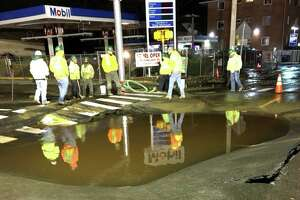 File photo of Aquarion workers at a water main break in Bridgeport, Conn., on Nov. 14, 2017.