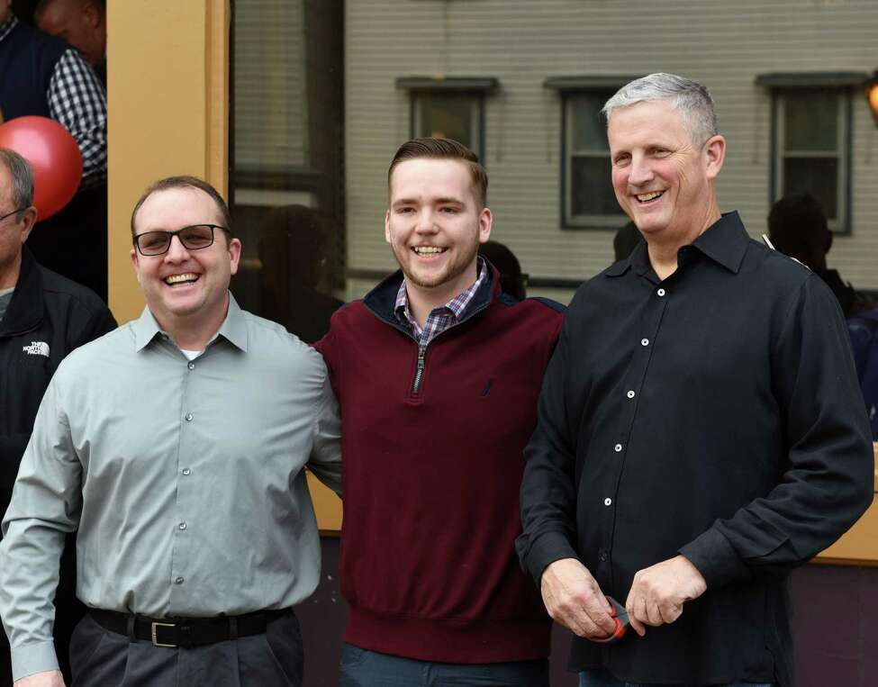 Anthony's Restaurant co-owners; Don Russell, left, Derek Villaneuve, center, and Bob Barbieri, right, pose for photo during a ribbon cutting event to mark their restaurant's opening on Tuesday, Feb. 25, 2020, in Cohoes, N.Y. The building was part of the 2017 Remsen Street fire, and was slated for demolition. (Will Waldron/Times Union)