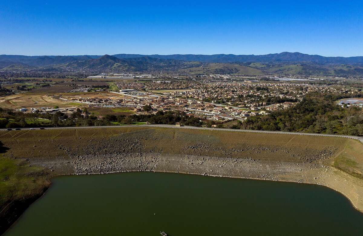 An aerial view of the dam and at homes below it at Anderson Lake Reservoir on Tuesday, Feb. 25, 2020 in Morgan Hill, Calif.