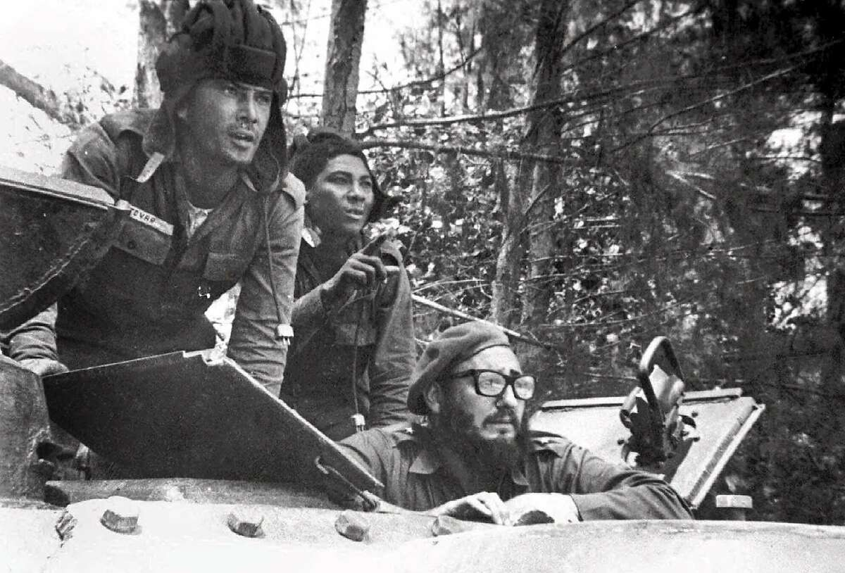 Cuban leader Fidel Castro, lower right, sits inside a tank near Playa Giron, Cuba, during the Bay of Pigs invasion, in this April 17, 1961 photo provided by Granma, the Cuban government newspaper. About 1,500 Cuban exiles, supported by the CIA, landed in Cuba in the Bahia de Cochinos (Bay of Pigs) on April 17, 1961 with the purpose of sparking a popular uprising and ousting the government of Cuban leader Fidel Castro. Most rebels were quickly captured or killed by the Cuban armed forces (CP Photo/Granma/Raul Corrales)