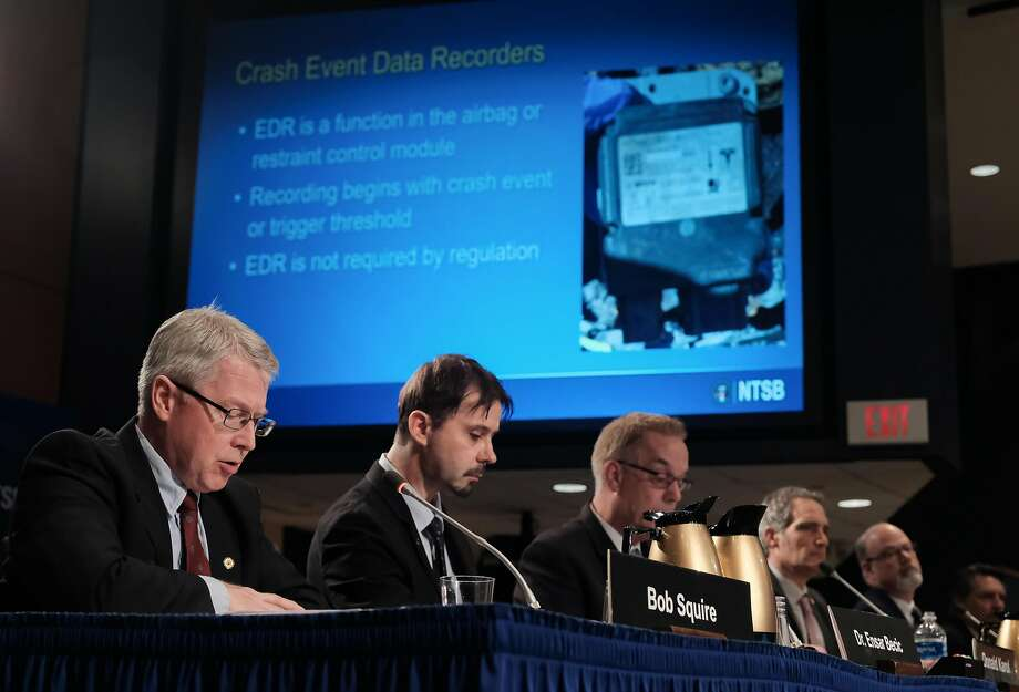 Members of the National Transportation Safety Board review findings on the probable cause of a fatal 2018 crash of a Tesla. Photo: Michael A. Mccoy / New York Times