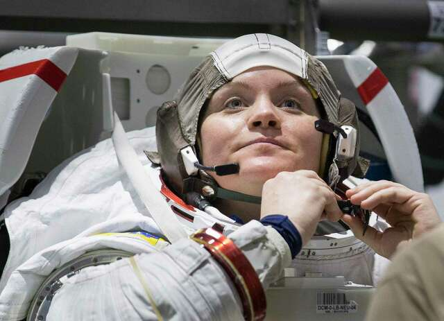 Astronaut Anne McClain suits up for spacewalk training at NASA's Neutral Buoyancy Laboratory on Tuesday, Feb. 25, 2020, in Houston.