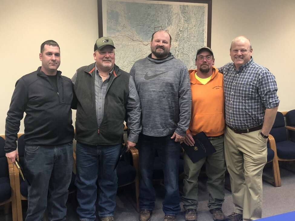 From left are Robert Crist, Jeff Gray, Preston Allen Jr., Aaron Colvin and a grateful Edward Fitzgerald whom they rescued from the waters of the Great Sacandaga Lake on Jan. 31.