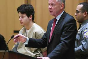 Guilford's Ellis Tibere, 18, and his attorney John Gulash in state Superior Court in Stamford on Monday.   24, 2020. The judge upheld the current bond at $1 million. Tibere was charged with attempted murder after allegedly repeatedly stabbing a 33-year-old Greenwich woman in her car in Westport.
