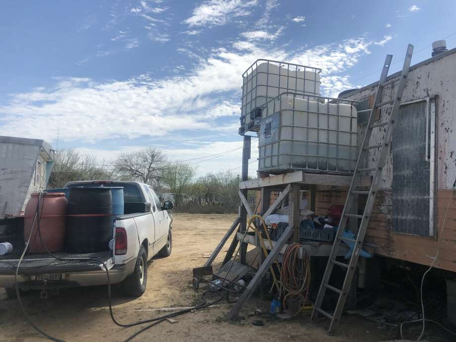 La Presa resident Evita Padilla goes twice a week to get water to fill the tanks outside her home, shown here. Photo: Julia Wallace/Laredo Morning Times