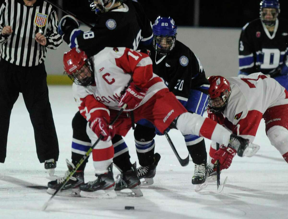 Greenwich's Thatcher Danielson (17) slaps the puck up the ice against Darien in the 3rd Winter Classic at the Greenwich Skating Club in Greenwich in December.