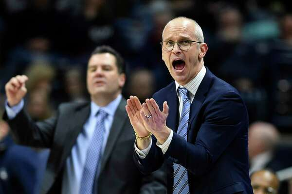 Connecticut head coach Dan Hurley cheers on his team during the second half of an NCAA college basketball game against South Florida Sunday, Feb. 23, 2020, in Storrs, Conn. (AP Photo/Stephen Dunn)