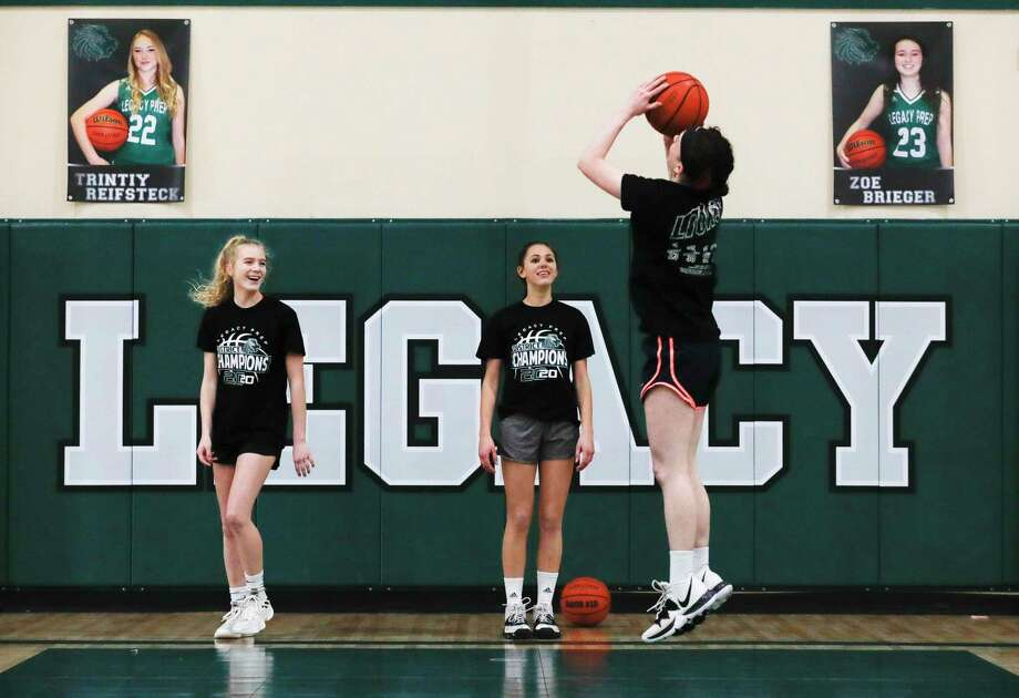 Maddie Steed, right, shoots a jump shot in front of Avery Davis, left, and Mary Wittmer during girls basketball practice at Legacy Preparatory Christian Academy, Friday, Feb. 21, 2020, in Magnolia. Photo: Jason Fochtman, Houston Chronicle / Staff Photographer / Houston Chronicle © 2020