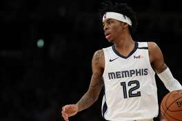 LOS ANGELES, CALIFORNIA - FEBRUARY 21: Ja Morant #12 of the Memphis Grizzlies dribbles the ball during the fourth quarter in a game against the Los Angeles Lakers at Staples Center on February 21, 2020 in Los Angeles, California. NOTE TO USER: User expressly acknowledges and agrees that, by downloading and or using this Photograph, user is consenting to the terms and conditions of the Getty Images License Agreement. (Photo by Katelyn Mulcahy/Getty Images)