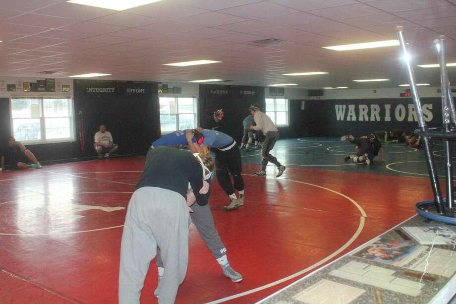 Chippewa Hills wrestlers practice in their wrestling room on Monday. (Pioneer/John Raffel)