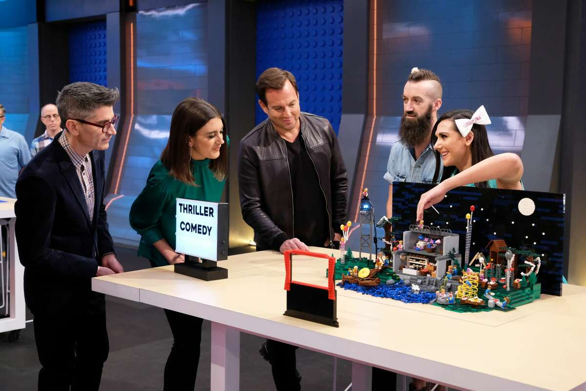 """LEGO MASTERS: L-R: Judges Jamie Berard and Amy Corbett with host Will Arnett and contestants Sam and Jessie in the """"Movie Genres"""" episode of LEGO MASTERS airing Wednesday, Feb. 26 (9:01-10:00 PM ET/PT) on FOX. ©2020 FOX MEDIA LLC. CR: Ray Mickshaw/FOX"""