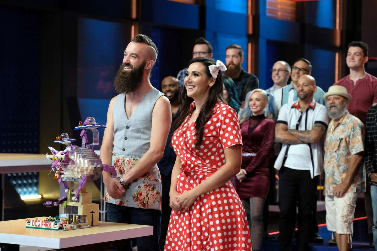 """LEGO MASTERS: L-R: Contestants Sam and Jessica in the """"Space Smash"""" episode of LEGO MASTERS airing Wednesday, Feb. 12 (9:01-10:00 PM ET/PT) on FOX. ©2020 FOX MEDIA LLC. CR: Ray Mickshaw/FOX"""