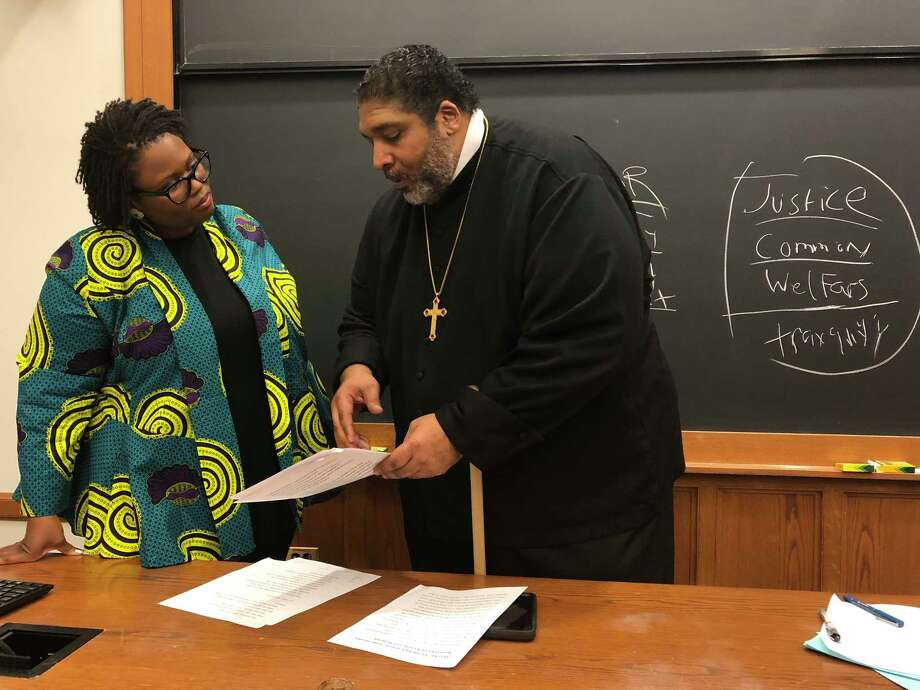 The Rev. William J. Barber, pastor of Greenleaf Christian Church in North Carolina and co-chairman of the national Poor People's Campaign, spoke with Yale Law School associate professor Monica Bell on Tuesday, Feb. 25. Barber, whose church has become a destination for presidential candidates, is calling for a presidential debate on poverty, and planning a Mass Poor People's Assembly and Moral March on Washington in June. Photo: Liz Teitz / Hearst Connecticut Media