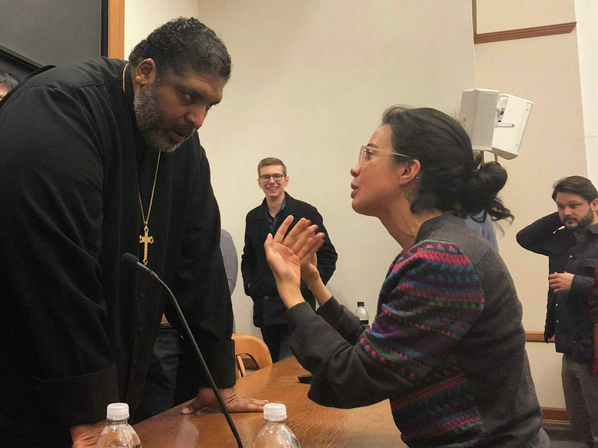 The Rev. William J. Barber, pastor of Greenleaf Christian Church in North Carolina and leader of the national Poor People's Campaign, speaks with recent Yale Law School graduate Roxana Moussavian on Feb. 25. Barber, who also organized the Moral Mondays protests in North Carolina, spoke at the law school about poverty, voter suppression and building a national movement for a
