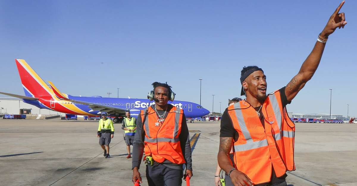 PHOTOS: Check out Rockets players working at Hobby Airport for a couple hours Houston Rockets Robert Covington (r) and Danuel House walk back to the terminal after aiding with ta Southwest Airlines departure at William H. Hobby Airport Tuesday, Feb. 25, 2020, in Houston.