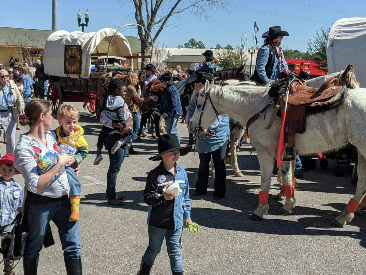 Sam Houston Trail Riders make their way through Tomball's Old Town Feb. 25. This is the 66th year the group has made the trip to the Houston Livestock Show and Rodeo.