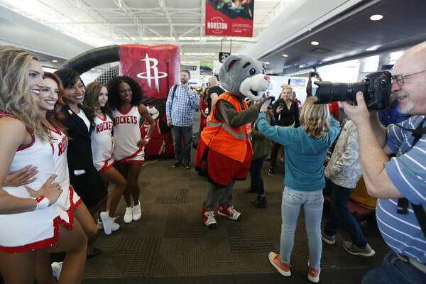 Houston Rockets Clutch City Dancers have their photo taken with Southwest Airlines passengers and employees at William H. Hobby Airport Tuesday, Feb. 25, 2020, in Houston.