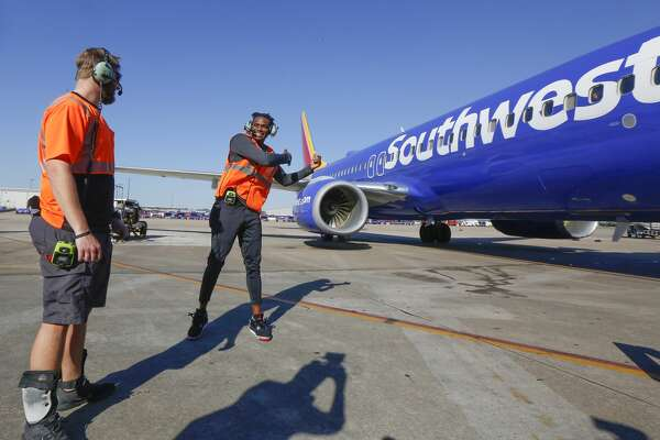 Houston Rockets Danuel House joked with Southwest Airlines Ramp Agent Brandon Yates before helping a plane to depart at William H. Hobby Airport Tuesday, Feb. 25, 2020, in Houston.