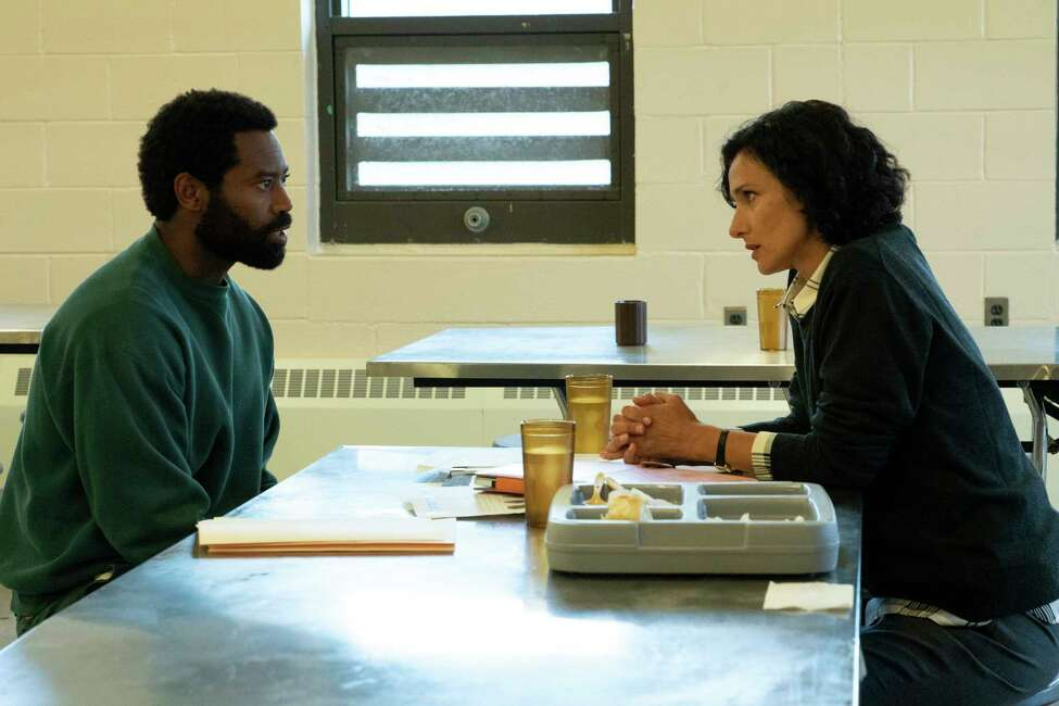 This image released by ABC shows Nicholas Pinnock, left, and Indira Varma in a scene from