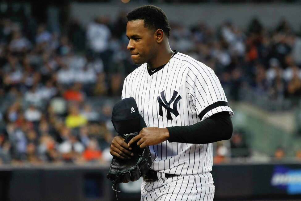 FILE - In this Oct. 15, 2019, file photo, New York Yankees starting pitcher Luis Severino leaves the game against the Houston Astros during the fifth inning in Game 3 of baseball's American League Championship Series in New York. Severino needs Tommy John surgery and will miss the 2020 season, another setback for the two-time All-Star and the rotation of the AL East favorites. a€œHis plan is to have it done as soon as possible,a€ Yankees general manager Brian Cashman said Tuesday, Feb. 25, 2020. (AP Photo/Matt Slocum, File)