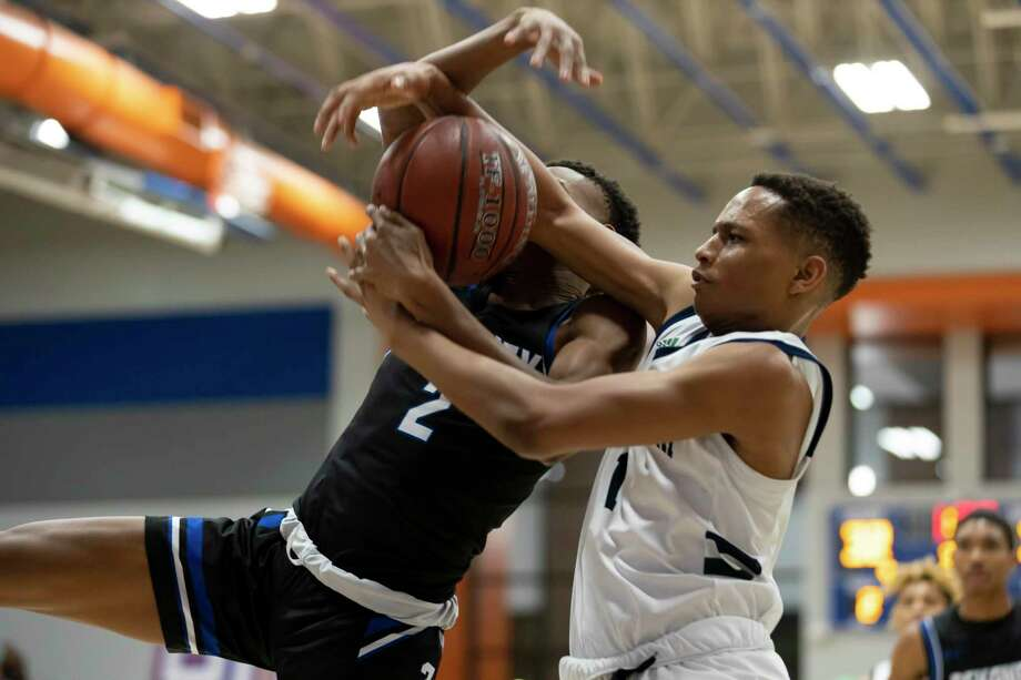 College Park guard Khi Watkins (1) steals a rebound from Dekaney guard Jayden Jackson (2) during the second half of a Region II-6A bi-district high school basketball game at Grand Oaks High School, Tuesday, Feb. 25, 2020, in Spring. Photo: Gustavo Huerta, Houston Chronicle / Staff Photographer / Houston Chronicle © 2020
