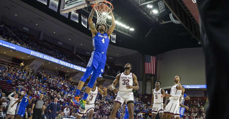 Kentucky forward Nick Richards (4) dunks over Texas A&M forward Josh Nebo (32) during the first half of an NCAA college basketball game Tuesday, Feb. 25, 2020, in College Station, Texas. (AP Photo/Sam Craft) Photo: Sam Craft/Associated Press
